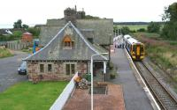 Rush hour at Golspie on 30 August 2007 as the 0923 to the far north pulls into the platform. (The group had arrived at the station on a tour bus 10 minutes earlier.)<br><br>[John Furnevel&nbsp;30/08/2007]