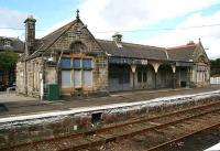 The former station building at Brora with a definite <I>left to rot</I> look about it in August 2007. The circular stone inserts above the windows read <I>HR</I> and <I>1895</I> respectively.  <br><br>[John Furnevel&nbsp;29/08/2007]