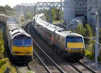 60029 brings the empty <I>Binliner</I> out of the landfill sidings at Oxwellmains on 19 September as a GNER Kings Cross - Edinburgh service passes on the ECML. <br><br>[Bill Roberton&nbsp;19/9/2007]
