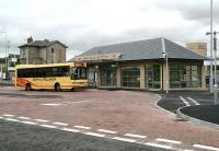 Rail passengers arrive at the recently opened Markinch Interchange on 20 September 2007 off a bus from Glenrothes. The old station building and booking office stands in the left background. <br><br>[John Furnevel&nbsp;20/09/2007]
