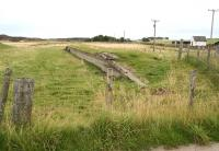 The platform remains at Skelbo alongside the former level crossing in 2007 looking south towards Dornoch. <br><br>[John Furnevel&nbsp;26/8/2007]