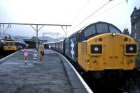 Class 37 with <I>The Royal Scotsman</I> at Dumbarton Central in 1985.<br><br>[John McIntyre&nbsp;//1985]