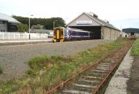An afternoon train for Inverness waiting to leave Wick on 28 August 2007. The modern building on the far side of the station is the new police headquarters.<br><br>[John Furnevel&nbsp;28/8/2007]