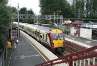 A Glasgow bound train pulls away from Dalreoch station on 9 September.<br><br>[John Furnevel&nbsp;/09/2007]