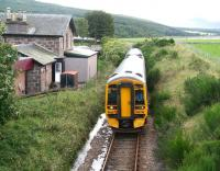 A train from the far north passing the long closed station at Meikle Ferry on 25 August 2007. The station was open for less than 5 years, closing on 1 January 1869, having been originally planned when consideration was being given to taking a direct route north from here across the Dornoch Firth.  <br><br>[John Furnevel&nbsp;25/08/2007]