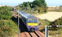 The 10.37 Waverley - North Berwick service, having left the ECML at Drem Junction on 2 October 2007, approaches the former Dirleton station, now mostly hidden by trees and in use as a holiday bed and breakfast establishment. <br><br>[John Furnevel&nbsp;02/10/2007]