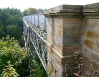 Looking south towards Roslin across the 1892 Bilston Glen viaduct in October 2007. The viaduct is one of the earliest examples of steel box lattice girder construction, with a 135m span. The category A listed structure underwent major restoration during the 1990s and is now part of a walkway. [See image 33123]<br><br>[John Furnevel&nbsp;04/10/2007]