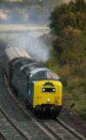 Deltic 55022 brings an SRPS Dundee - Oban excursion around the curve at Inverkeithing Central Junction on a chilly 6 October morning.<br><br>[Bill Roberton 6/10/2007]