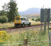 An Aquarius PW Roadrail vehicle approaching Kildonan station on 27 August 2007, having reversed north along the section from Rogart on an inspection trip [see image 20547].<br><br>[John Furnevel&nbsp;27/08/2007]