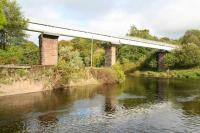 View north east across the Endrick Water towards Balfron on 11 October, showing the stone piers of the former Drymen Viaduct and the water pipeline, with walkway above, that now spans the river.  <br><br>[John Furnevel&nbsp;11/10/2007]