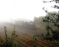 A <I>touch of fog</I> over North Lancs on 13 October as an ethereal 48151 departs Carnforth past the Virtual Quarry sidings. <br><br>[John McIntyre&nbsp;13/10/2007]