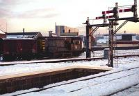 A low Winter sun illuminates the snow covered south end of Aberdeen station in November 1973 as D3877 undertakes shunting duties in the adjacent Guild Street yard.<br><br>[John McIntyre&nbsp;21/11/1973]