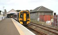 Afternoon train for Inverness standing at Thurso on 28 August, alongside a surviving goods shed.<br><br>[John Furnevel&nbsp;28/08/2007]
