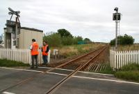 Maintenance and testing of warning lights and audible alarm being carried out at Bridge Street open level crossing, Halkirk, on 28 August 2007. View is northeast towards Georgemas Junction over the site of the former Halkirk station (closed 1960) which stood just beyond the crossing. Three occupants of a car tragically died as a result of a collision with a train on this crossing in September 2009. <br><br>[John Furnevel&nbsp;28/08/2007]