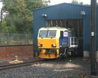 DR 98958 stands at the entrance to the wheel lathe shed at Craigentinny on 28 September 2007, awaiting the next fall of leaves. Photographed from a passing train.<br><br>[John Furnevel&nbsp;28/09/2007]