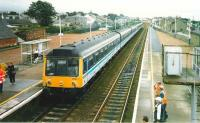 A 6-car 117 set about to head south ecs from Carnoustie during the 1999 <I>Open</I>. <br><br>[David Panton&nbsp;17/07/1999]