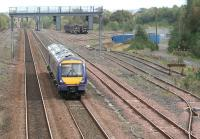 View east over Cadder yard on 27 September 2007 with an afternoon Edinburgh - Glasgow Queen Street train approaching.<br><br>[John Furnevel&nbsp;27/09/2007]