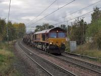 66221 passing through Johnstone with Irvine to Bescot empty china clay tanks<br><br>[Graham Morgan&nbsp;18/10/2007]