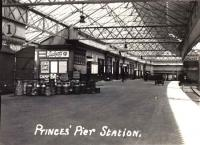 A postcard view of Princes Pier station, probably during the 1920s or 1930s, showing a scene typical of many stations at that time, with milk churns standing on the platform next to a van with an open door.<br><br>[A Snapper (Courtesy Bruce McCartney)&nbsp;//]