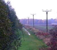 Looking west from Gallowhill Road, the solum of the line heading for Kinross Junction. In fact recently the local Perth & Kinross Council have paved the pathway.<br><br>[Brian Forbes&nbsp;26/10/2007]
