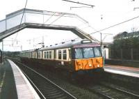 303021 forming a Partick - Carstairs (Mon-Fri only) service stops at Carluke on 30 March 1998. <br><br>[David Panton&nbsp;30/03/1998]