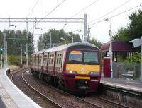 320307 brings a Helensburgh train into Carntyne on 16 September.<br><br>[David Panton 16/09/2007]