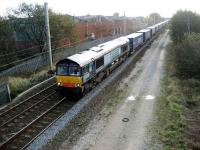 A DRS class 66 with the Tesco containers at Coppull, Lancs on 9 November heading for Grangemouth. <br><br>[John McIntyre&nbsp;09/11/2007]