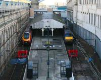 The former <I>sub</I> platforms 8&9 outside the south wall of the main station seen looking east from Waverley Bridge on 14 November, with long distance services boarding at both. These platforms remain terminated at their western ends meantime as a result of the extensive engineering work that has been taking place.    <br><br>[John Furnevel&nbsp;14/11/2007]