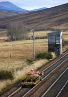 A pair of 6 seater trolleys and tractor unit passing the former Dalnacardoch box on 15 November. <br><br>[Bill Roberton&nbsp;15/11/2007]