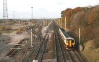 Looking north on the WCML over the remains of the once mighty Kingmoor marshalling yard on 3 November, with the last of the buildings that stood alongside the up departure sidings now demolished.<br><br>[John Furnevel&nbsp;03/11/2007]