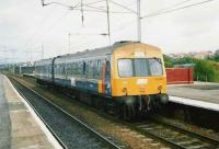 Experimental liveried 101 692 with a Cumbernauld - Motherwell service at Coatbridge Central in July 1997.<br><br>[David Panton&nbsp;/07/1997]