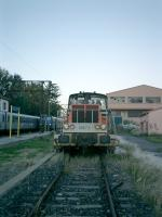 <B>SNCF 8473</B> at Ille-sur-Tet siding while trains pass in the station on the Perpignan to Villefranche-sur-Conflent line.<br><br>[Alistair MacKenzie 02/11/2007]