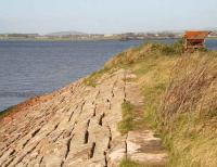 View north across the Solway Firth on 6 November showing the remains of the embankments that once supported the Solway viaduct. The metal structure top right is/was used by cockle gatherers in the area.  <br><br>[John Furnevel&nbsp;06/11/2007]