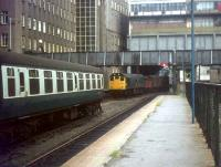 A freight about to run through platform 8 at the unrebuilt north end of Aberdeen in the 70s. The old north box still stands on the right and the coaching stock occupies the then truncated platform 7.<br><br>[Ian Dinmore&nbsp;//]