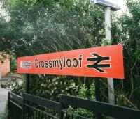 Station nameboard at Crossmyloof in July 1998. <I>Strathclyde Red</I> (clearly orange) in all its glory.<br><br>[David Panton&nbsp;/07/1998]