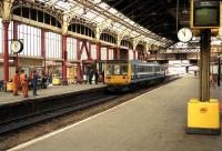 A Regional Railways class 142 stands at platform 2 at Preston station in 1990.<br><br>[John McIntyre&nbsp;//1990]