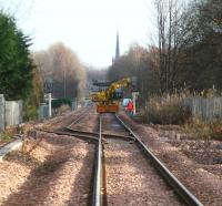 View towards Alloa from Cambus level crossing on 29 November 2007 showing Alloa West loop with work in progress on one of the signals. In the background stands the imposing spire of the church of St Mungo (1819) in Bedford Place.<br><br>[John Furnevel&nbsp;29/11/2007]