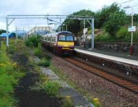 View west along the disused platform at Craigendoran on 4 August as a Helensburgh Central service commences the final leg of its journey.<br><br>[Ewan Crawford&nbsp;04/08/2007]