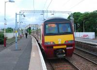 A westbound service pauses at Cardross on 13 June.<br><br>[Ewan Crawford&nbsp;13/06/2007]