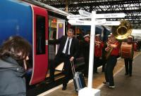 First Group CEO Moir Lockhead is serenaded aboard the FTPE special to Glasgow Central at Waverley on 4 December 2007 celebrating the launch of the First TransPennine Express services linking Edinburgh and Glasgow with Manchester Airport. [The names on the signpost refer to locations featured in a talk by travel journalist Simon Calder at the pre-launch bash in a well known local hotel.]<br><br>[John Furnevel&nbsp;04/12/2007]