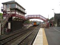 Service for Carlisle stops at the staggered westbound platform at Haltwhistle on 15 October 2006.<br><br>[John McIntyre&nbsp;15/10/2006]