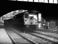 A short freight for Guild Street yard hauled by a class 26 rumbles south under Union Street Bridge and past Aberdeen North box in February 1973.<br><br>[John McIntyre&nbsp;/02/1973]