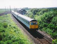 Looking towards Drem Junction in June 1995 as 305 502 leaves the ECML and runs onto the branch with a service for North Berwick.<br><br>[David Panton&nbsp;/06/1995]