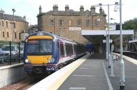 A Fife service standing in the new platform 0 bay at Haymarket on 6 September 2007 with the original 1842 E&G building as a backdrop and the rear of the 1862 Caledonian Alehouse (formerly the Haymarket Station Bar) to the left... though not for much longer... [see image 20669]<br><br>[John Furnevel&nbsp;06/09/2007]