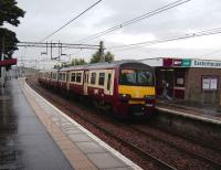 320 316 with a Helensburgh Central service arrives at Easterhouse on a wet 15 September.<br><br>[David Panton&nbsp;15/09/2007]