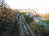 Looking north from the Bedford Road bridge over the Waterloo branch, with the site of Kittybrewster station just before the square building in the middle distance.<br><br>[John Williamson&nbsp;17/12/2007]
