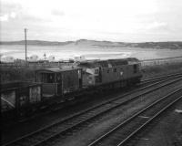 A class 26 shunts the daily goods from Aberdeen, Craiginches into the yard at Fraserburgh, on a fine day in the late spring of 1972. (The guard obviously enjoyed having his photograph taken).<br><br>[John Williamson&nbsp;/05/1972]