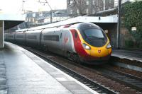 The 1010 Edinburgh - London Euston pulls into platform 4 at Haymarket on 20 December. The Pendolino works into Waverley each morning as the 0840 <I>local</I> from Carstairs (to which it runs <I>empty stock</I> from Glasgow Central) [See image 15040].<br><br>[John Furnevel&nbsp;20/12/2007]