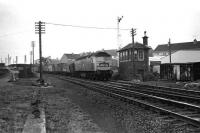 A class 47 takes a container train north towards Aberdeen through the site of the former Cove station on 07 December 1974.<br><br>[John McIntyre&nbsp;07/12/1974]