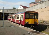 318 262 on a Dalmuir - Larkhall service at Exhibition Centre on 8 September.<br><br>[David Panton&nbsp;08/09/2007]